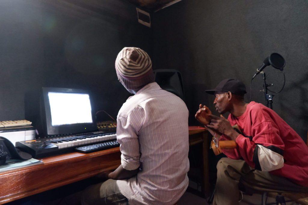 Musicians working in recording studio.